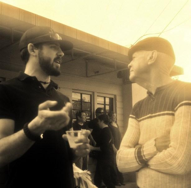 Maverick Hunter talks to Mike Casey at Rick Hunter's wake. Photo by Page Graham.