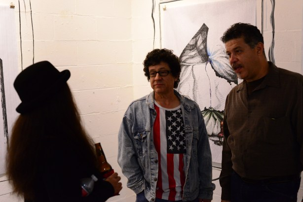 """Luis Valderas at 3rd Space Gallery talking with visitors, November """"2nd Saturday"""" 2013. Photo by Page Graham."""