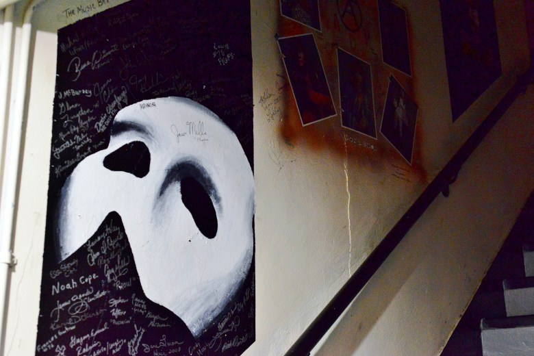 Tucked into a back stairwell, this mural was created by the cast and crew of Phantom of the Opera. Photo by Page Graham.