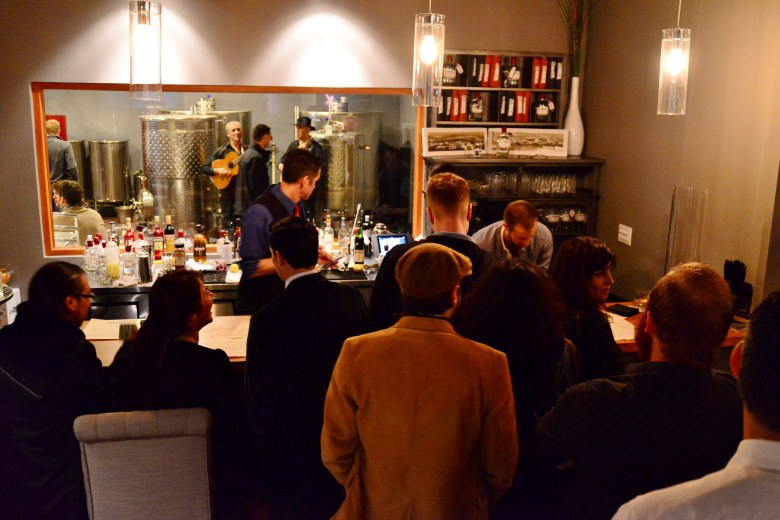 At the opening party, a small crowd awaits Rakia cocktails made by mixologists for 1919 bar. Photo by Page Graham.