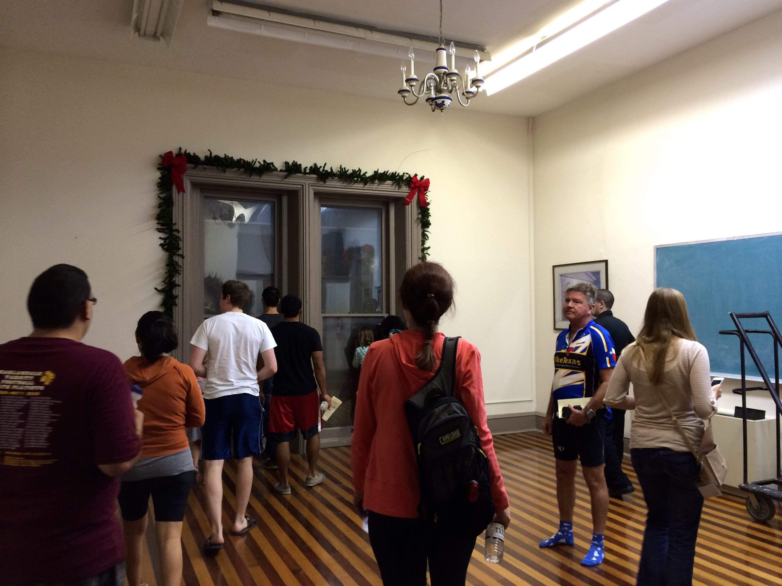 Our group tours one of the many spacious rooms inside The Commanders House. Photo by Jaime Solis