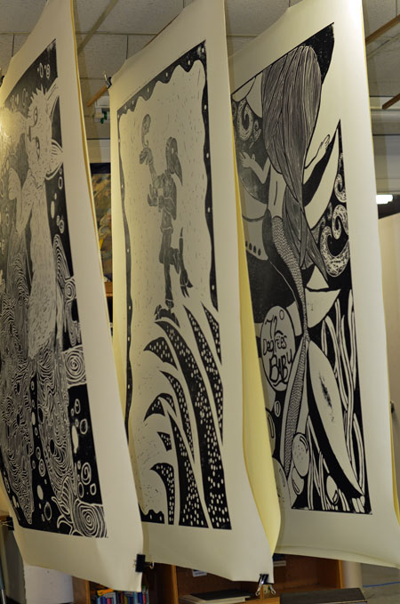 Some relief prints designed by San Marcos residents and high school hang to dry for about three weeks in a classroom at Centro Cultural Hispano de San Marcos.