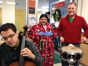 Cristine Godea, 15, joins the Principal Percussionist Riely Francis and Cellist Noe Benavidez for a song. Photo by Robert Rivard