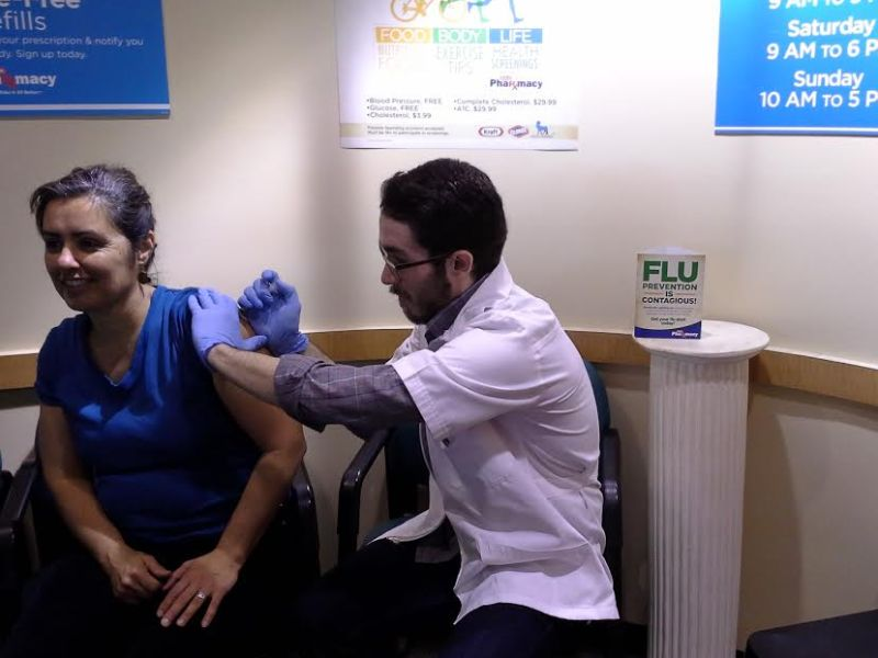 The author (Cheris Rohr) receiving a flu shot at Central Market pharmacy. Available for $27.
