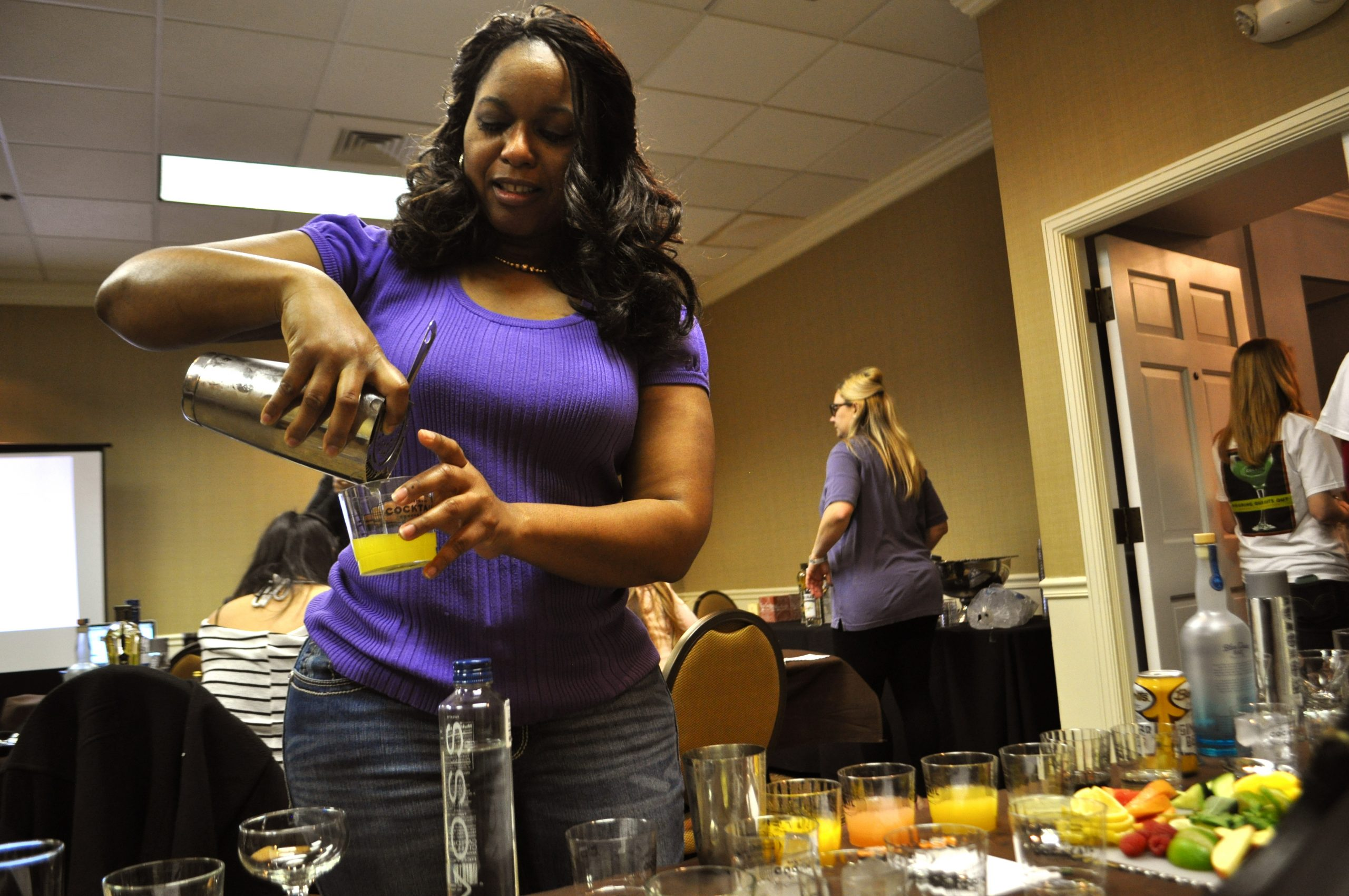 """Heather Hunter pours her own signature cocktail created during the 2014 San Antonio Cocktail Conference seminar """"Mixology 101."""" Photo by Iris Dimmick."""