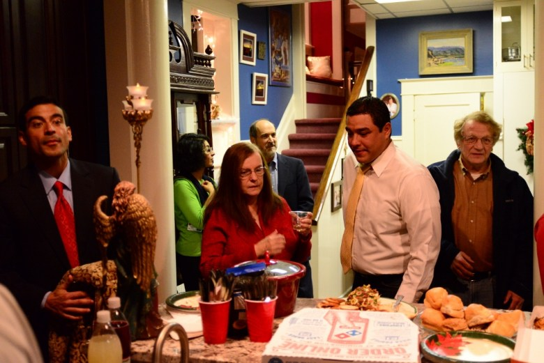 Political candidates and those who are passionate about the political process gather around the community table to grab a snack and perhaps a glass of wine. Photo by Page Graham.