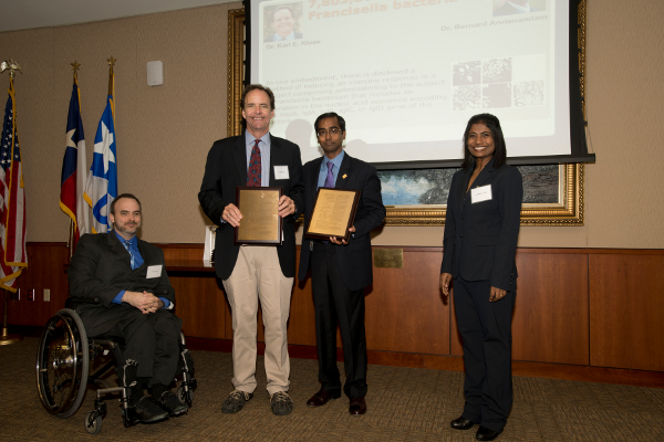 Dr. Karl E. Klose and Dr. Bernard Arulanandam receive awards for their patents on Francisella Tularensis Bacterium. The awards were presented by Neal Guentzel and Dr. Subashini Asokan. Photo courtesy of UTSA.