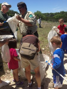 Texas Parks and Wildlife bird guru Craig Hensley teaches kids about butterflies at the Kreutzberg Canyon Natural Area May Day Celebration. Photo by Bekah McNeel.