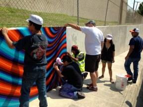 Installing Alex Rubio's mural on the Nolan Street underpass. Courtesy photo