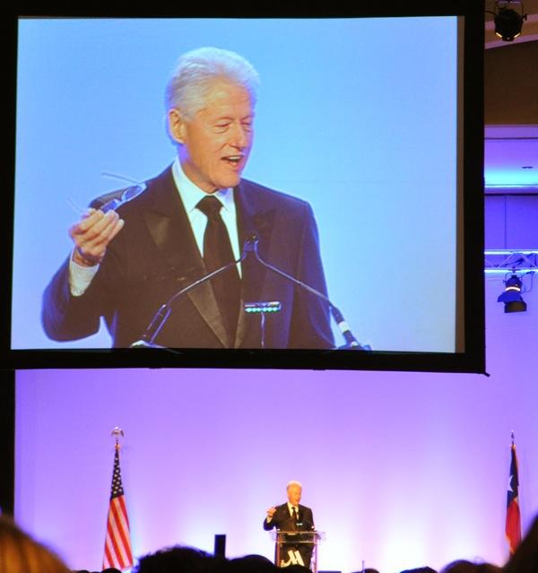 Bill Clinton speaks at the 2014 International Citizen Award banquet honoring Henry Cisneros. Photo by Iris Dimmick.