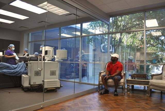 A patient's loved-one waits patiently as she's prepared for optical surgery. Photo by Iris Dimmick.