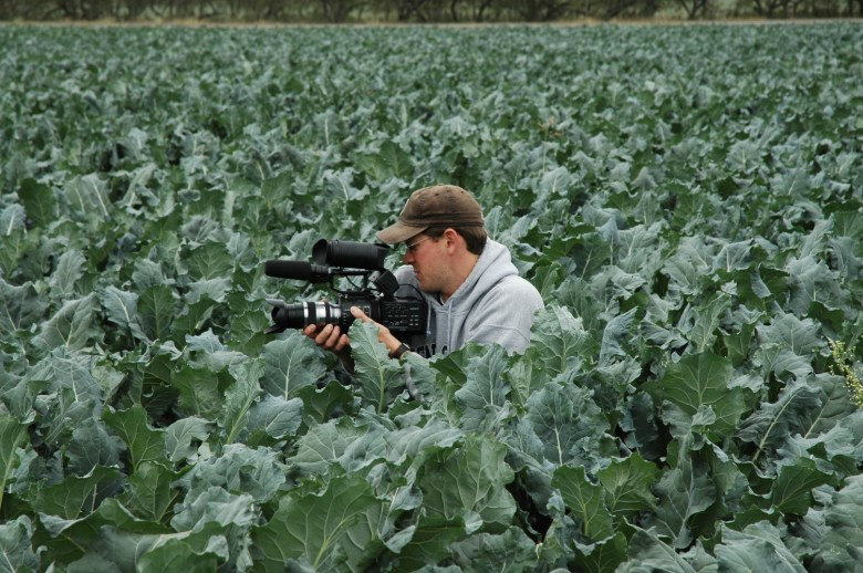 """Filmmaker Mark Stitzer films on a farm in Uvalde for the documentary film """"Water Blues, Green Solutions."""" Courtesy photo."""