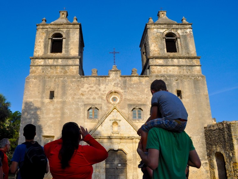 A family admires the recently restored Mission Concepcion during a Something Monday bike ride in July 2013. Photo by Iris Dimmick.