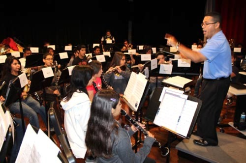 Ricky Flores, an assistant principal at Burbank High School directs students during a district-wide band camp in Summer 2013. Photo courtesy of SAISD.