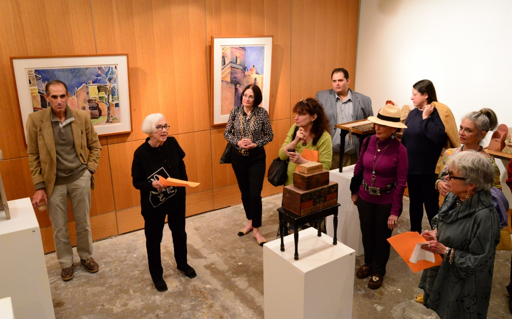Marilyn Lanfear (second from left) discusses her work at her retrospective show at Hausmann Millworks. Photo by Page Graham.