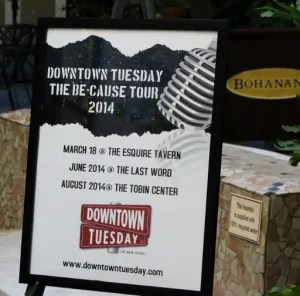 A poster listing upcoming Be-Cause events displayed at the Downtown Tuesday anniversary celebration. Photo by Page Graham.