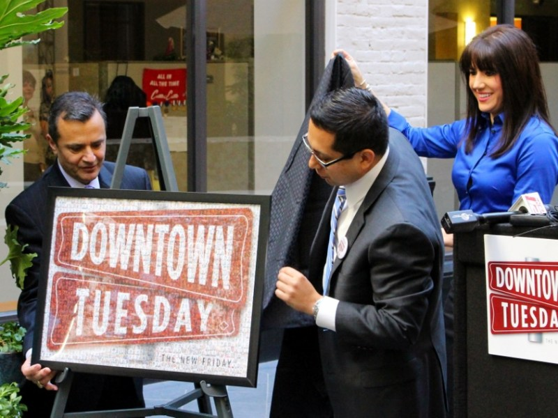 (From left) Assistant City Manager Carlos Contreras, District 1 Councilman Diego Bernal, and Center City Development Office Director Lori Houston unveil a photo image of the Downtown Tuesday logo. Photo by Page Graham.