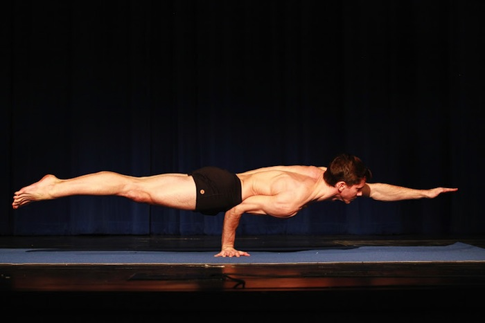 Adult Male Second Place recipient Jared McCann executes a pose during the 2014 National USA Yoga Asana Championship at the Aztec Theatre March 14-16. Photos by Stacy Pape/USA Yoga Federation.