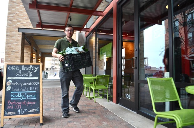 LocalSprout CEO Mitchell Hagney delivers fresh, hydroponically-grown  produce to One Lucky Duck, a juice bar at the Pearl Brewery. Photo by Iris Dimmick.