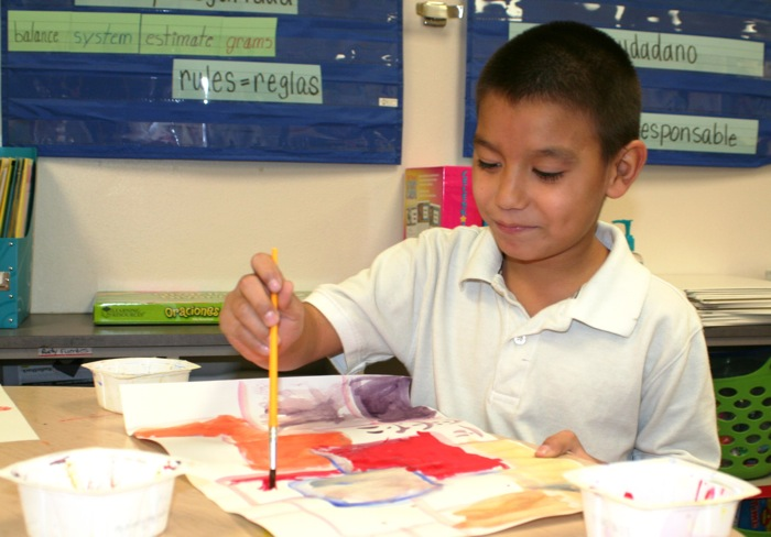 A Rogers Elementary School student works on a painting. Photo courtesy of SAISD.