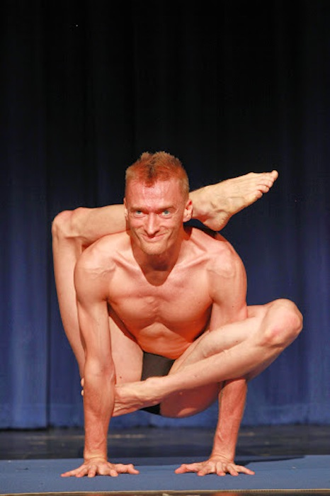 """Adult Male First place recipient Zeb Homison executes the """"Om"""" pose during the 2014 National USA Yoga Asana Championship at the Aztec Theatre March 14-16. Photos by Stacy Pape/USA Yoga Federation."""