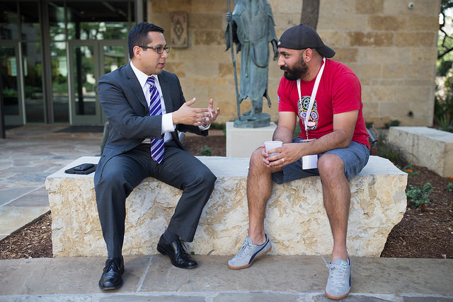 District 1 Councilman Diego Bernal (left) talks with 80/20 Foundation Executive Director Lorenzo Gomez at the Briscoe Western Art Museum during the Codeup Demo Day April 22, 2014. Photo by Scott Ball.