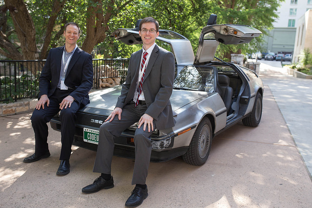 Codeup Founder Michael Girdley and Chris Turner pose on the Codeup DeLorean during the Codeup Demo Day April 22, 2014. Photo by Scott Ball.