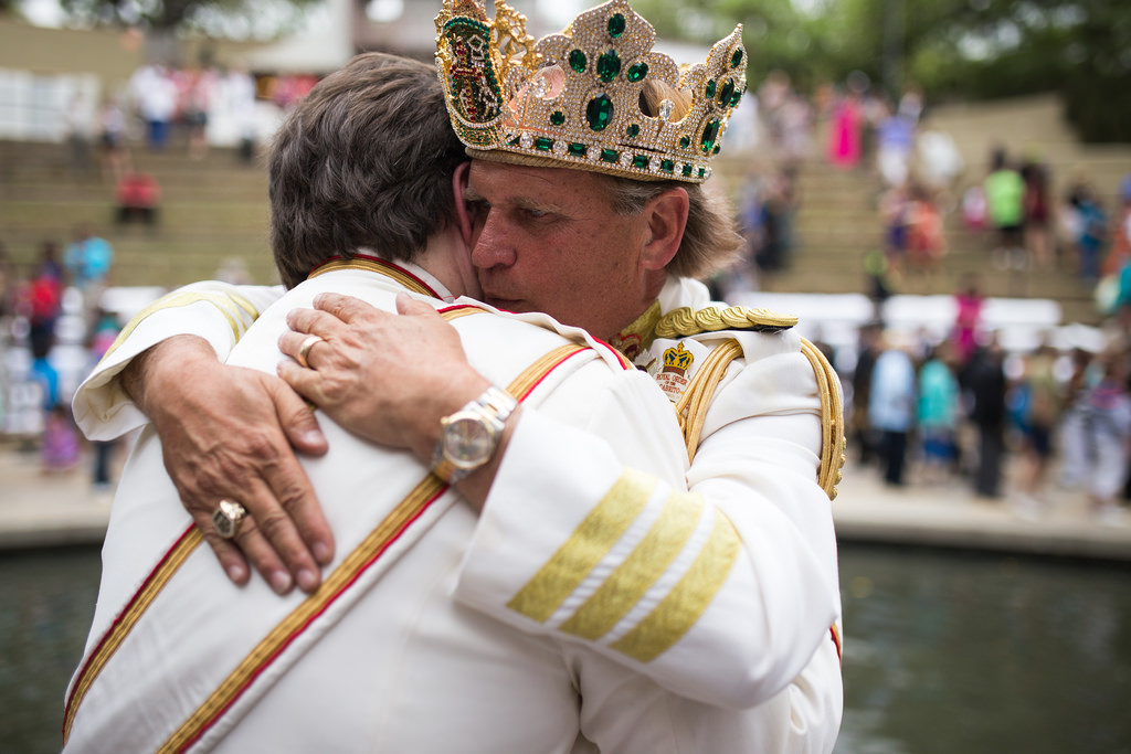 Jimmy Green, El Rey Feo LXVI, embraces a member of his court after the crowning. Photo by Scott Ball.