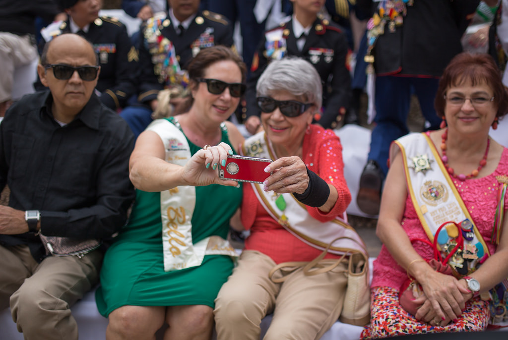 Taking selfies during the crowning of El Rey Feo LXVI on Saturday April 19, 2014. Photo by Scott Ball.