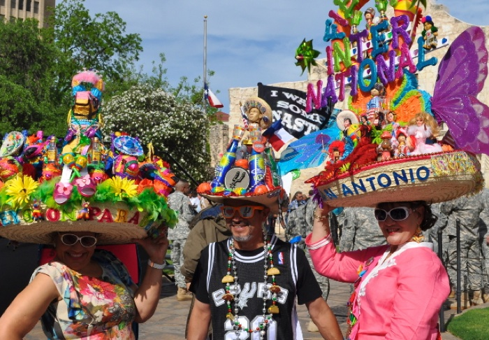 "2013 ""Fiesta Fiesta"" revelers at the opening ceremony in front of the Alamo Cathedral. Photo by Iris DImmick."