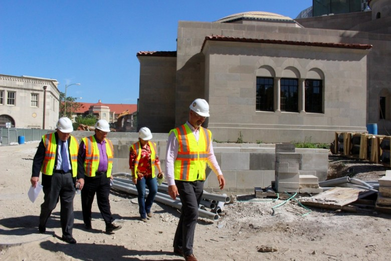 Christopher Novosad leads a safety gear-clad group of visitors through the construction site. Photo by Page Graham.