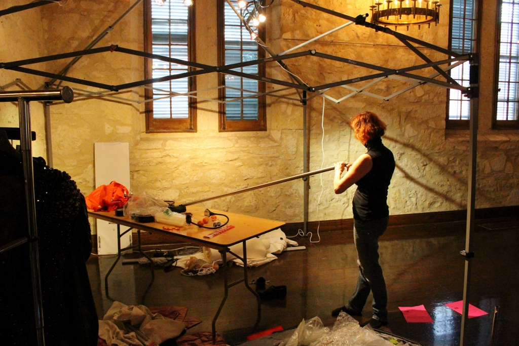 Starr Hagenburg sets up her booth the day before Fiesta Arts Fair. Photo by Page Graham.