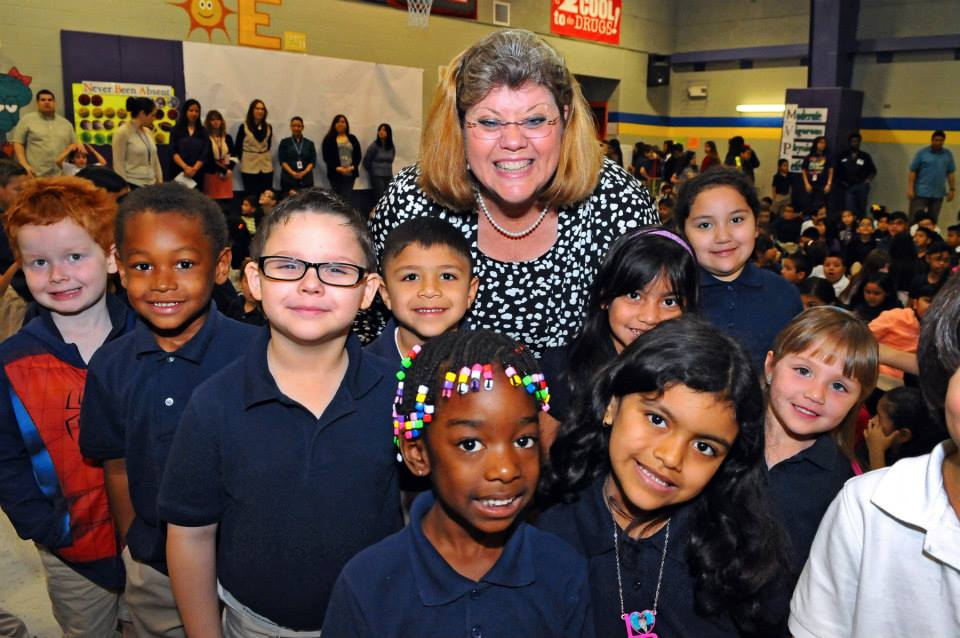 Laura Roberts, principal, Woodlawn Hills Elementary in SAISD poses for a photo after being surprised with a $1,000 H-E-B Excellence in Education finalist check. Photo courtesy of H-E-B.