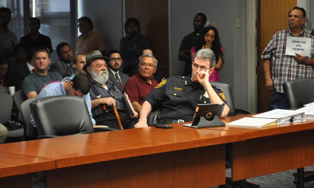 """SAPD Chief McManus listens to the citizens signed up to speak at the Public Safety Committee meeting regarding """"rideshare"""" companies in San Antonio. Photo by Iris Dimmick."""