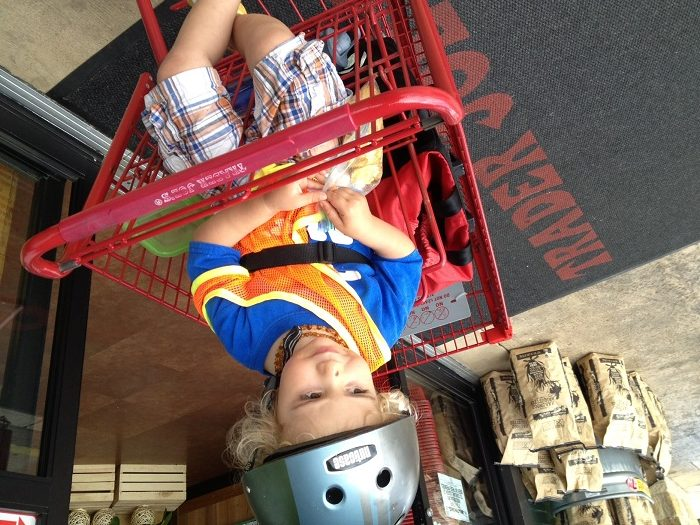 Rizo trades in two wheels for four when we arrive at Trader Joes. Photo by Anna CohenMiller.