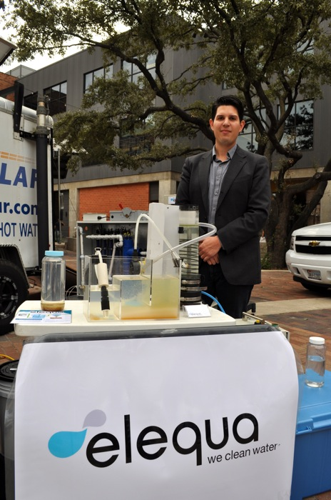 Ryan Beltrán stands at an Elequa demonstration booth before an Eagle Ford Shale Forum at the Pearl Stables. Photo by Iris Dimmick.