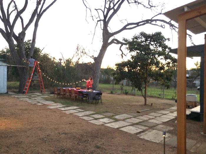 Bekah McNeel sets the backyard dinner table. Photo by Lewis McNeel.