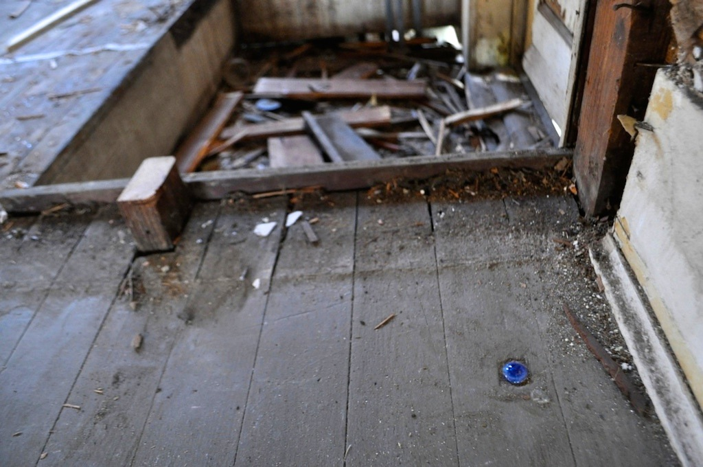 Cotton Estes and Mike Long's recently purchased, under construction home in Dignowity Hill. They recently discovered that a previous owner had patch a floor hole with a marble. Photo by Iris Dimmick.