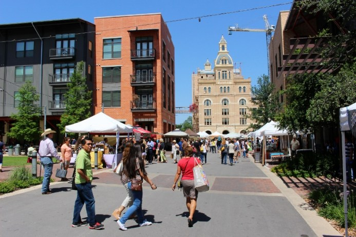 Buildings old and new give the Pearl Farmers Market an urban vibe. Photo by Page Graham.