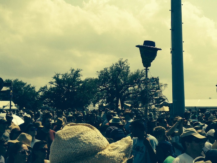 The crowd gathers during 2014 New Orleans Jazz and Heritage Festival. Photo by Adam Tutor.