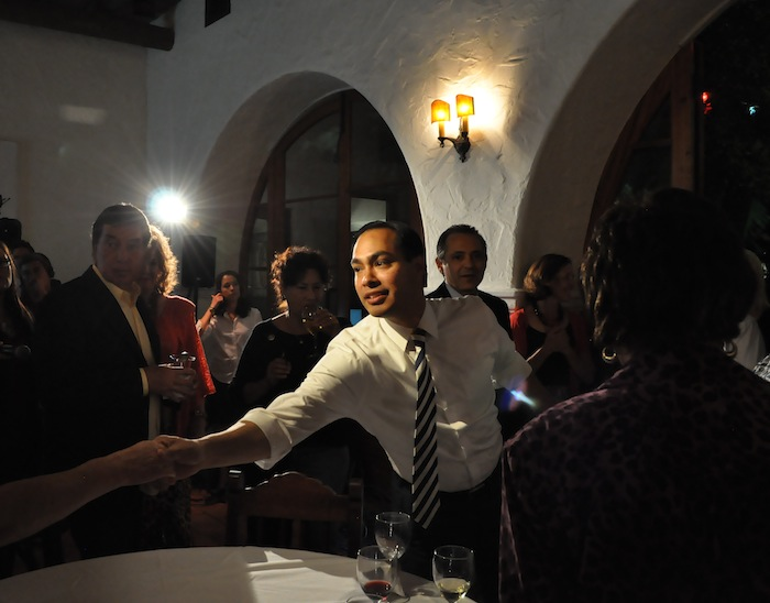 Mayor Julián Castro stretches to shake hands as he makes his way through the crowd gathered at La Fonda on Main to hear election night results. The Pre-K 4 SA initiative passed on Nov 6, 2012. Photo by Iris Dimmick.
