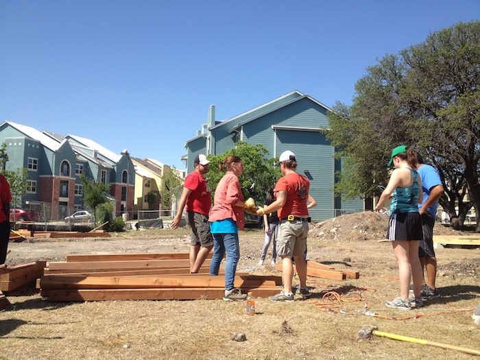 Volunteers help build the large community garden at Sutton Oaks on May 3. Photo by Mitch Hagney.