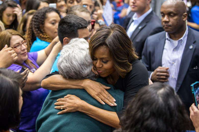 First lady Michelle Obama visits UTSA to talk about her college enrollment initiative during College Week. After he talk, she  embraces Rosio Alvarado a senior at McCollum High School who is headed to attend UTSA.  Photo by Scott Ball.