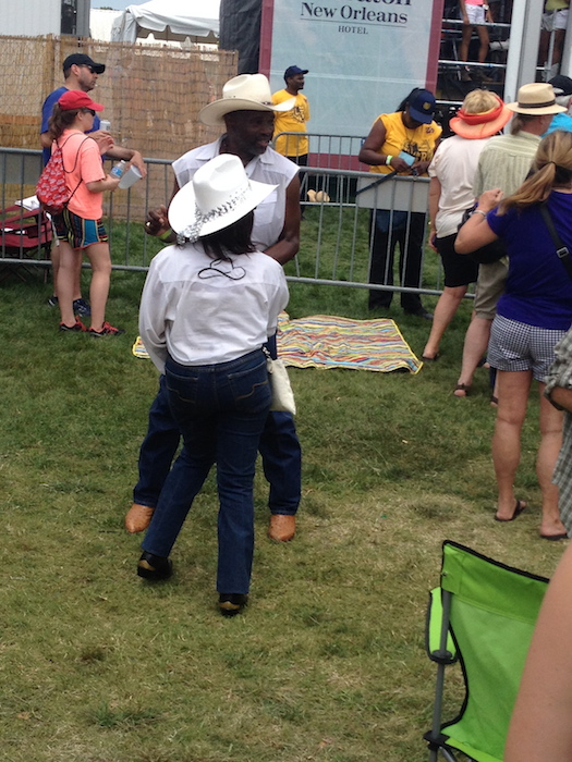 Boot Scootin' Boogiers at the Fais Do-Do Stage during the 2014 Jazz Fest in New Orleans. Photo by Adam Tutor.