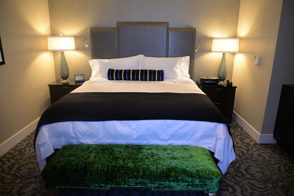 """The new bedrooms at the St. Anthony Hotel feature a bedside electronic pad. Gone are the days of """"Do not disturb"""" signs. Guests can program that feature from their pad; it creates a colored circle around the room's doorbell which alerts the housekeeping staff. Photo by Annette Crawford."""