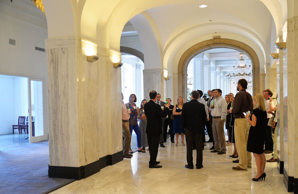 Guests gather in the lobby of the St. Anthony Hotel May 21 during the Urban Land Institute Project Tour. They're standing in front of what used to be the reception and check-in desk. Photo by Annette Crawford.