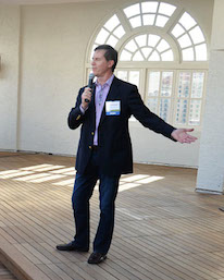 Robert Shemwell, FAIA, LEED AP, Principal at Overland Partners, speaks to guests of the Urban Land Institute Project Tour on the 10th floor terrace at the St. Anthony Hotel. Photo by Annette Crawford.