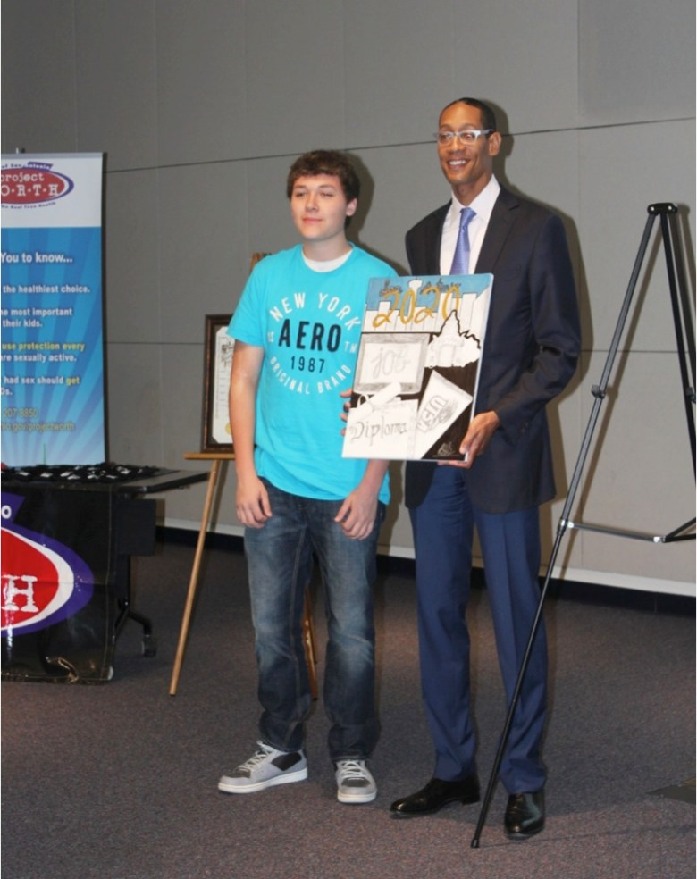 SA2020 President and CEO Darryl Byrd with a student and his artwork at the National Day to Prevent Teen Pregnancy press conference on Wednesday, May 7, 2014. Photo by Mario Martinez, SAMHD.