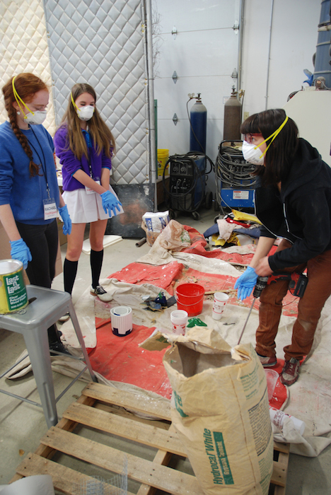 You[th]Pace Teen Art Council members work with artist Liz Glynn to mix concrete for sculptures. Photo by Taylor Browning