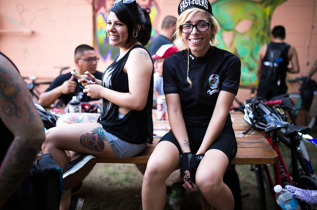 Annie Klemm waits on a table before the Alleycat bike ride on June 13, 2014. Photo by Scott Ball.